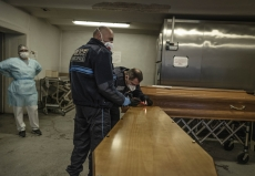 MULHOUSE, FRANCE- 28 MARCH 2020: Policemen are sealing the coffin of  awoman who died of Covid 19 before it's taken off by Jeremy Walter.  (Picture by Veronique de Viguerie/Getty Images)