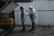 MULHOUSE, FRANCE- 5 APRIL 2020: Bouli and Alain, undertakers arrive tat the Bantzaheim Ephad to get two bodies of old pensioners who died overnight. Hey have to come directly with the coffins because they died of Covid. (Picture by Veronique de Viguerie/Getty Images)