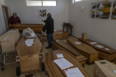 MULHOUSE, FRANCE- 5 APRIL 2020: Bouli and Alian have troubles to find some space for the 2 coffins they brought with the pensionners of the Ephad. In the garage, 17 coffins, 13 of them are from Covid victims.  (Picture by Veronique de Viguerie/Getty Images)