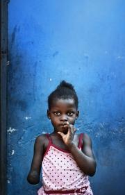 PORT-AU_PRINCE, HAITI-NOV, 2014: Anaika avait 20 jours lors du tremblement de terre. Elle a perdu son bras droit lorsque sa maison s'est ecrasee sur elle et sa maman, Marie-Denise. Aujourd'hui, dimanche, elle part a la messe. (Photo by veronique de Viguerie/Reportage by getty images).