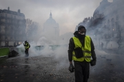 "PARIS, FRANCE - DECEMBER 01: December 1, 2018 in Paris, France. The demonstrators, known as ""gilets jaunes"" or ""yellow vests,"" have protested across France for the last two weeks, demanding a reduction in fuel prices. French law requires drivers to carry yellow vests in case of accident. (Photo by Veronique de Viguerie/Getty Images)"