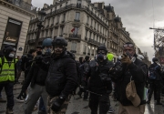 "PARIS, FRANCE - DECEMBER 01: Clashes between the police and the Yellow Vests nearby the Champs Elysées on December 8, 2018 in Paris, France. The demonstrators, known as ""gilets jaunes"" or ""yellow vests,"" have protested across France for the last two weeks, demanding a reduction in fuel prices. French law requires drivers to carry yellow vests in case of accident. (Photo by Veronique de Viguerie/Getty Images for the Washington Post)"