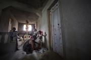 PORT-AU_PRINCE, HAITI-NOV, 2014: Valentine Calixte, beneficiaire de Pamis, prepare sa fillette pour aller a l'ecole. L'ecole est l'une des depense premiere des foyers en Haiti. (Photo by veronique de Viguerie/Reportage by getty images).