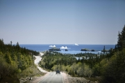 BONAVISTA, NEWFOUNDLAND-JUNE, 2014: Iceberg echoues dans la baie de Bonavista, a Terre Neuve. Route empruntee par la camion de transport de l'eau d'iceberg d'Ed Kean. Road used by the Iceberg water truck. Icebergs in Bonavista Bay. (Picture by Veronique de Viguerie/Reportage by Getty Images).