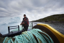 SWEET BAY, NEWFOUNDLAND- JUNE, 2014: Ed Kean is attaching the barge to the iceberg. (Picture by veronique de Viguerie/Reportage by Getty Images.)