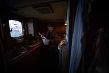 GREEN WATERS, NEWFOUNDLAND-JUNE, 2014: Captain Nelson Pittman is reading a newspaper in the kitchen on board. (Picture by Veronique de Viguerie/Reportage by Getty Images).