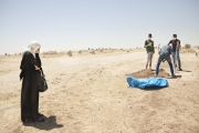 MOSUL, IRAQ- JULY, 2017: Families are getting back the bodies of their relatives trapped under the rubbles. Time for Mosul inhabitants to burry their dead ones. Sahida mother-of-seven is burrying the remains (2 legs) of her brother Miasr Sabar Ahmed (45) killed by ISIS 2 montsh ago as he was trying to escaope with his 4 children in one of Mosul graveyard.5Picture by Veronique de Viguerie/Reportage by Getty Images)