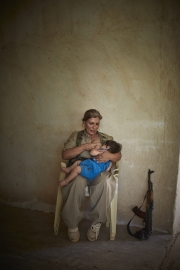 KURDISTAN, IRAQ-SEPTEMBER, 2014: Shaista Rarmani (36) is breastfeeding her son Saamal (10-months-old).  A militia part of the democrat Parti of the iranian faction of the Kurdish Guerilla. Picture by Veronique de Viguerie/Reportage by Getty Images)