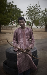 MAIDUGURI, NIGERIA-JUNE, 2014: A young vigilante armed with an arrow is at a check point at Maiduguri's entrance. (Picture by Veronique de Viguerie/Reportage by Getty Images)