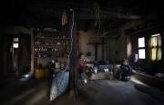 SIMIGAON, NEPAl-APRIL, 2015: Pem-Cheki, veuve, reste seule avec son troisième fils, Dawa Tachi à Simigaon alors que ses 3 autres frères, eux, ont la chance d'étudier à Katmandou (Picture by Veronique de Viguerie/Reportage by Getty Images)