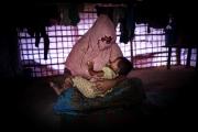 COX BAZAR, BANGLADESH- SEPT, 2018: (Faux prénom) Taslima (30) a été violée par les soldats Birmans en août 2017 alors qu'elle était enceinte de son mari. La famille arrivée au camp, son mari l'a abandonnée. Elle a mis au monde Shushuma agée de 6 mois, toute seule. Tous les voisins pensent qu'elle est le fruit du viol et la stigmatise. Ils ne veulent pas que Shushuma rentre chez eux, ni l'approcher. Talsima se retrouve isolée.  (Picture by veronique de Viguerie/Getty Reportage)