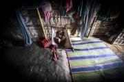 """COX BAZAR, BANGLADESH- SEPT, 2018: Mahmoud Hassan agé de 4 mois, ne sort jamais de sa tente. Il est """"fils de birman"""", concu à la suite du viol de sa mère par deux soldats birmans. Bébé de la honte, personne ne veut le voir et reproche à sa mère Fatema (faux prenom) 30 ans, de l'avoir gardé, même ses propres filles.(Picture by veronique de Viguerie/Getty Reportage)"""