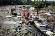 OKRIKA, NIGER DELTA, NIGERIA- JULY, 2016: The toxic refineries are everywhere polluting the water the air and employing no locals. A fisherman is going to his boat in Okrika. (Picture by Veronique de Viguerie/ Reporatge by getty Images).