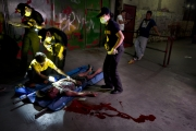 MANILA, PHILIPPINES - OCT, 2016: The dead body of a suspected drug gangster was found by the police in Santa Cruz quarter. As for most of them the police found a 38 mm in his left hand and 2 shabu paquets. The police is accused of placing evidences on bodies killed in this war on drug. (Picture by Veronique de Viguerie/ Reportage by Getty Images).