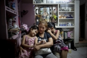 MANILA, PHILIPPINES - OCT, 2016: Rita and her daughters, Maria Samantha (5) and Kheila (7) is grieveing her husband. Flor John (34), drug user, was executed by some apparent policemen at his house on the 19th of October. He was the father of three and married with Rita Cruz.  (Picture by Veronique de Viguerie/ Reportage by Getty Images).