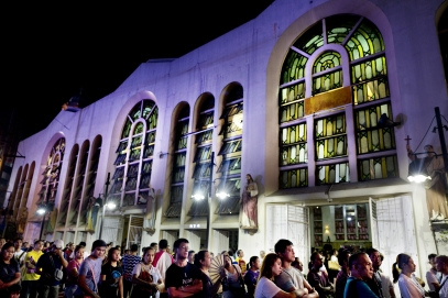 MANILA, PHILIPPINES - OCT, 2016: The Black Nazarin, Kuiapo church attracts thousands of fidels. They queue outside, watching the mass on a big screen. Flor John was a fidel of this church, having a reputation for miracles.  (Picture by Veronique de Viguerie/ Reportage by Getty Images).
