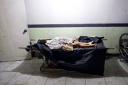 MANILA, PHILIPPINES - OCT, 2016: The savaged body of a 7-year-old girl is waiting in a morgue. The police is accusing a former drug addict to have raped then killed her. The police wants to publicize the case to justify its war on drugs which already made more than 3000 victims in  less than 4 months. (Picture by Veronique de Viguerie/ Reportage by Getty Images).