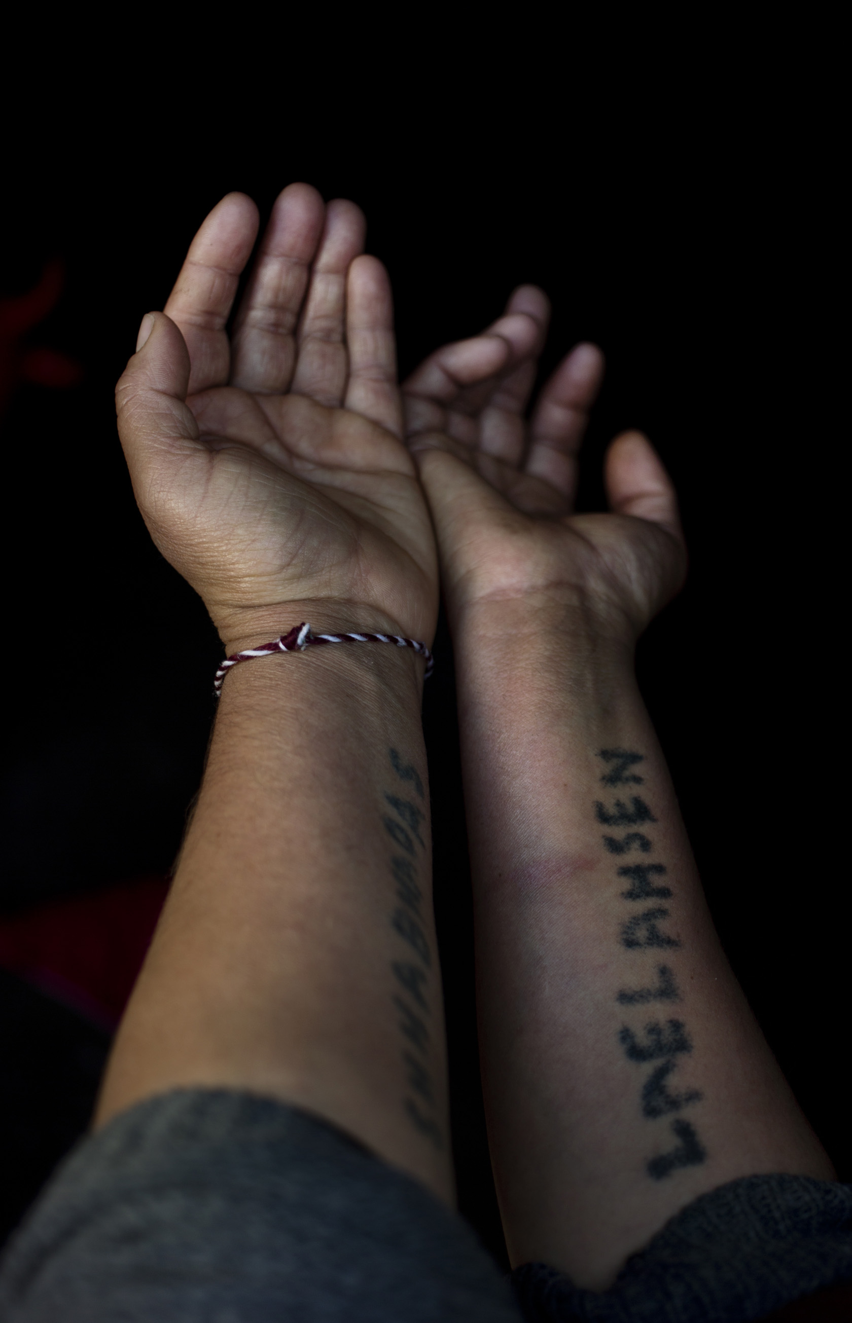 DOHUK, KURDISTAN- FEBRUARY, 2016: Sévé 32 ans a été enlevée avec ses 6 enfants. Pendant sa détention, elle a brodé les numeros de telephone de membres de sa famille pour ne pas les oublier et elle a gravé le nom de son mari et de son frère sur ses bras pour qu'on leurs remettent son corps si elle venait à mourir. Pour que sa fille ne soit pas violée elle l'a déguisée en petit garcon. Ils vivent au camp de Kankhe où il n'y a que des déplacés Yézidis. (Picture by Veronique de Viguerie/ Reportage by getty Images).