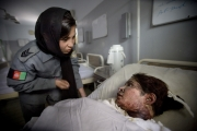 KABUL,AFGHANISTAN-JUNE 2009- Sidiqa Sultani, 25, policewoman based in Police station 6 in Kabul, is investigating the case of 17-year-old girl who had 85% of her body burnt. Sidiqa at Esteklal hospital is trying to understand what happened by questioning the family, to see if the husband or anybody else is guilty or responsable of this drama.( Photo by Veronique de Viguerie/Getty Images for Marie-Claire France)