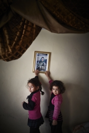 KABUL, AFGHANISTAN-APRIL, 2013: Omullbanin Bakhtar (5)and her sister Maryam (6) are looking at their mother's portrait, Amina, a female Special Force, currently on operation in another province in KAndahar. (Picture by Veronique de Viguerie/Reportage by Getty Images)