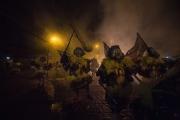 RIO, BRESIL-MARCH, 2019: Les membres du gang des Cobras ont revetu leurs costumes de Bate Bola et s'apprêtent à sortir dans leur favela dans le nord de Rio. C'est sur cette place à Marechal Hermes que le lendemain il y aura une tuerie entre les membres ds Cobras (qui protegent le quartier) et un autre ganag, Les Camelias. (Picture by Veronique de Viguerie/Getty Reportage)