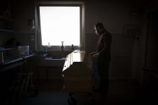 PARIS, FRANCE - 23 MARCH 2020: Guillaume Lantz dans la chambre funéraire de son entreprise de pompes funèbres. Depuis une semaine ils ont à traiter 70 décès au lieu des 25 d'une semaine normale. Leur chambre funéraire est pleine avec 6 corps, dans les frigos, dans les chambres, tous morts du Covid 19. Devant lui celui d'un patient décédé hier à l'hôpital.  (Picture by Veronique de Viguerie)