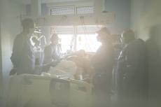 93, ILE DE FRANCE- 22 APRIL 2020: Hayette Kachour, infirmière cardre des urgences à la clinique de Stains dans le 9-3. Hayette se rend au chevet de pateints atteints de Covid en reanimation pour verifier des plaies.(Picture by Veronique de Viguerie/Getty Reportqge)