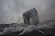 """PARIS, FRANCE - DECEMBER 01: Clashs between police nad Gilets Jaune on Place de l'Etoile, December 1, 2018 in Paris, France. The demonstrators, known as """"gilets jaunes"""" or """"yellow vests,"""" have protested across France for the last two weeks, demanding a reduction in fuel prices. French law requires drivers to carry yellow vests in case of accident. (Photo by Veronique de Viguerie/Getty Images)"""
