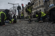 """PARIS, FRANCE - DECEMBER 01: Clashes between the police and the Yellow Vests nearby the Champs Elysées on December 8, 2018 in Paris, France. The demonstrators, known as """"gilets jaunes"""" or """"yellow vests,"""" have protested across France for the last two weeks, demanding a reduction in fuel prices. French law requires drivers to carry yellow vests in case of accident. (Photo by Veronique de Viguerie/Getty Images for the Washington Post)"""