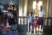 PORT-AU_PRINCE, HAITI-NOV, 2014: Valentine Calixte, beneficiaire de Pamis, prepare les dejeuners de ses enfants avant qu'ils ne partent a l'ecole. L'ecole est l'une des depense premiere des foyers en Haiti. (Photo by veronique de Viguerie/Reportage by getty images).