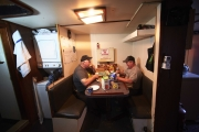 GREEN WATERS, NEWFOUNDLAND-JUNE, 2014: Captain Ed Kean and Ingeneer Philip Kennedy are taking their breakfast on board at sunrise. (Picture by Veronique de Viguerie/Reportage by Getty Images).