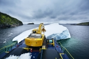 SWEET BAY, NEWFOUNDLAND-JUNE, 2014: To harvest the iceberg, Ed Kean uses a grabber who can take off a 500 kg of ice from the iceberg each time. The harvesting of the iceberg. (Picture by Veronique de Viguerie/Reportage by Getty Images)