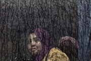 MOSUL, IRAK- APRIL, 2017: An Iraqi woman fleeig the fighting in Mosul, is taken by bus to an IDP camp nearby.