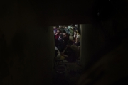 MOSUL, IRAK- APRIL, 2017: It's 25 days that these nine families are trapped in the basement of this house, on the frontline. They ran out of food and water. They are suffocating because of a gaz attack and trying to protect their mout to avoid inhalating the gaz, not even knowing what is it.  Since a couple of hours, the house is under ERD control and the '30 civilians will be evacuated to an IDP  camp as soon as it will be safe for them to move outside.