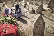 ERBIl, IRAQ-SEPTEMBER, 2014: Mrs Hosseini is grieving on her 19-years-old daughter's garve. Nigar was a Peshmerga, fighting against ISIS when she was killed 3 days ago, on the 6th of September 2014.  Picture by Veronique de Viguerie/Reportage by Getty Images)