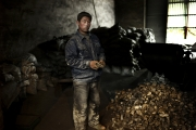 BAOTOU, CHINA-FEBRUARY, 2011 : A worker is holding a piece of metal alloy made of metals and rare earth, easy to export  by-passing the quotas regulations. (Photo by Veronique de Viguerie/Reportage by Getty Images)