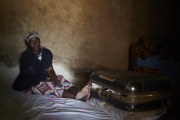 CHIBOK, NIGERIA-JUNE, 2014: Yana in her daughter's bedroom. Rifkatu kept all her clothings in this suitcase. She was kidnapped on the 14th of April. (Picture by Veronique de Viguerie/Reportage by Getty Images).