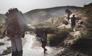 COX'S BAZAR, BANGLADESH- JAN, 2018: 700000 Rohingyas refugges are in Kutapalong camp. They need fire to cook their food. They are stripping the mountains nearby of their forest for the wood. Each mornings they are thousands to leave for the day, they have to walk for 3 hours, then they have to give 20 TK to some bangladeshi with weapons to be allowed to cut wood. Then they have to walk back at the end of the day with heavy wood on their back. Most of men and children go once a week and take enough wood for the whole week of cooking. (Picture by Veronique de Viguerie/ Reportage by Getty Images)