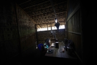 SITTWE, MYANMAR- JUNE, 2015:Rohingya people are not allowed to work, neither to get out of the camp. Many men left to work abroad and send some money back to their families in Myanmar. Wives are speaking sporadicly to their husbands, sons via skype in very rudimentar internet cafes. (Picture by Veronique de Viguerie/Reportage by getty Images).