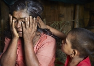 SITTWE, MYANMAR- JUNE, 2015:  Bodouba Camp. Rahana (45), mother-of-nine is crying over the disappearance of her 19-years-old duaghter and her 12-years-old son. They both got hooked by some brokers. The son called them a few weeks ago, he was in the hands of traffickers in Thailand who asked for 600 USD to release him. They have no news of the girl. (Picture by Veronique de Viguerie/Reportage by getty Images).