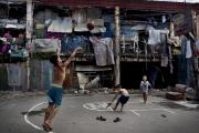 """MANILA, PHILIPINES- JUNE, 2017: Le quartier """"happyland"""" est l'un des plus pauvre de Manille. A l'ouest de Manille, 120000 habitants qui votent Duterte à 80%. Et même si il est acusé de mener non pas une guerre contre la drogue mais une guerre contre les pauvres, il reste très apprécié.  Happyland neighborhood is one of the poorest of Manila.  In Westerne Manila with 120 000 inhabitants, 80% voted for Duterte. Duterte remains very popular there despite the fact that he is accused of engaging a war against the poor instead of a war against the drug. (Picture by Veronique de Viguerie/ Reportage by Getty Images)"""