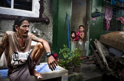 MANILA, PHILIPPINES - OCT, 2016: A man is watching the coffin, during the wake of his neighbourg friend, drug user, killed the 7th of october. (Picture by Veronique de Viguerie/ Reportage by Getty Images).