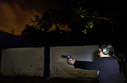 MANILA, PHILIPPINES - OCT, 2016: Captain Leny Leticia Pasco (51) in charge of the Baranguay Libis in Quezon City. Since she started her fight against drugs, she is practising at the shooting range and has a gun at home for protection. (Picture by Veronique de Viguerie/ Reportage by Getty Images).