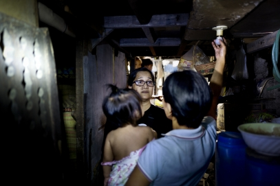 MANILA, PHILIPPINES - OCT, 2016: Captain Leny Leticia Pasco (51) in charge of the Baranguay Libis in Quezon City. She is visiting Ananbel, mother-of-four, former drug user, on the Watch List.  (Picture by Veronique de Viguerie/ Reportage by Getty Images).