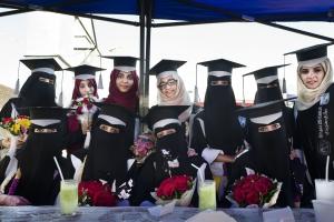 SANAA, YEMEN- NOV, 2017: Girls are outnumbering boys in IT, Sciences, Law universities. Ready to have a playing role in Yemeni traditional society. Newly graduated girls are celebrating in a restaurant in Sanaa.Les filles sont désormais plus nombreuses dans les Universités de Sciences, IT, Droit. Les femmes sont prêtes à endosser de nouveaux rôle décisifs, sortir du carcan traditionnel. De jeunes diplômées célèbrent l'obtention de leurs diplômes dans un restaurant à Sanaa.