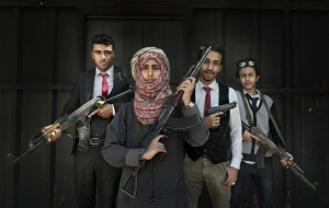 SANAA, YEMEN- NOV, 2017: 17-years-old Amat Allah Hassan, Prime Minister of the children government, is fighting corruption, the use of child soldiers and child marriage. She works with some other child ministers, from left, Ahmed Abdalh Al Showpi (17) minister of health, Amat, Asad Dahak (18) minister of roads, highways and public work and Ahmed Hani Aman (16) minister of fishing. They carry weapons to protect themselves as they are fighting against corruption, using social medias to uncover important people bad actions etc... And they are trying to help anyone who ask for it. For example a man ask Ahmed health minister some help for his ill son. Together with other child ministers they made a campaign and rise enough money for the man son to be cured. Amat is scared of nobody and speaks with all sides, Salah, Houthis and even Hadi's side. She wish to become a president and my guess is that she might well become one. She is very connected, respected and appreciated with a very very big mouth... Amat, 17 ans, premier ministre du ministère des enfants qui compte 33 membres. Ils luttent contre la corruption, le recruitement des enfants soldats, les mariages précoces et bien d'autres problèmes de la societe Yemenite. Amat peut compter sur ses anges, Ahmed Abdalh Al Showpi (17) ministre de la santé, Asad Dahak (18) ministre des routes et des batiments publics et Ahmed Hani Aman (16) ministre de la pêche. Ils sont toujours armés.
